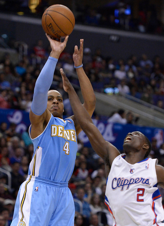 . Denver#4 Randy Foye shoots over Clippers#2 Darren Collison in the second half. The Los Angeles Clippers defeated the Denver Nuggets 117 to 105 in a regular season NBA game. Los Angeles, CA. 4/15/2014(Photo by John McCoy / Los Angeles Daily News)