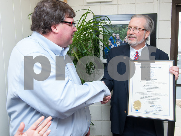 02/20/18 Wesley Bunnell   Staff Collier Electric Corp celebrated 25 years in business with presentations on Tuesday morning by Mayor Erin Stewart and Representative William Petit Jr. President Scott Pehmoeller shakes hands with Representative William Petit Jr. as Petit presents a citation from the state.