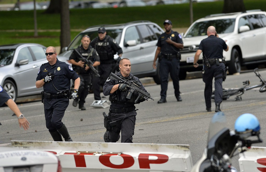 """. Police run after shots fired were reported near 2nd Street NW and Constitution Avenue on Capitol Hill in Washington, DC, on October 3, 2013.  The US Capitol was placed on security lockdown Thursday after shots were fired outside the complex, senators said. \""""Shots fired outside the Capitol. We are in temporary lock down,\"""" Senator Claire McCaskill said on Twitter. Police were seen running within the Capitol building and outside as vehicles swarmed to the scene. The lockdown has been lifted, according to media reports.  AFP Photo/Jewel SAMAD/AFP/Getty Images"""