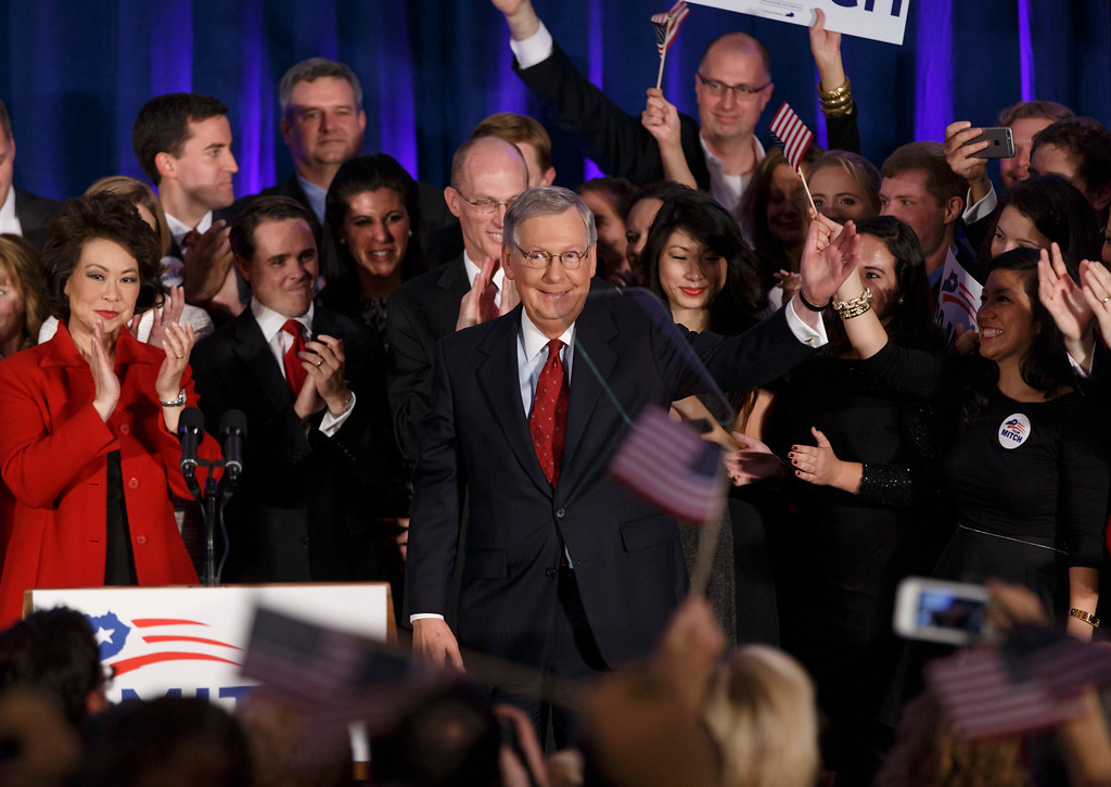 . In this Tuesday, Nov. 4, 2014 file photo, Senate Minority Leader Mitch McConnell, R-Ky., celebrates with his supporters at an election night party in Louisville, Ky., joined by his wife, former Labor Secretary Elaine Chao, left. McConnell won a sixth term in Washington. For months, political oddsmakers sought to calculate if Republicans had a chance to gain control of the U.S. Senate. It turned out there was no suspense - the GOP won 54 of the Senate\'s 100 seats, expanded its already strong majority in the House of Representatives, and gained at the state level, where Republicans now hold 31 governorships. (AP Photo/J. Scott Applewhite, File)