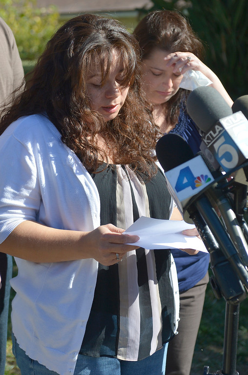 . Ana Hernandez stands with her friend Amy Sharp during a press conference on the front lawn of her home the day after her husband, TSA Behavior Detection Officer Gerardo Hernandez, was killed by a gunman in Terminal 3 at Los Angeles International Airport. Los Angeles, CA. 11/2/2013. photo by (John McCoy/Los Angeles Daily News)