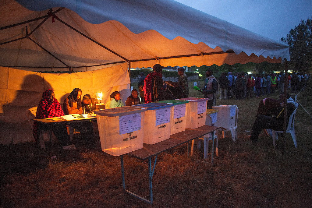 . Voters stand in line to vote at Manyatta Primary School polling station in west Nairobi at dawn on March 4, 2013 during the elections. Long lines of Kenyans queued from far before dawn to vote Monday in the first election since the violence-racked polls five years ago, with a deadly police ambush hours before polling started marring the key ballot. The tense elections are seen as a crucial test for Kenya, with leaders vowing to avoid a repeat of the bloody 2007-8 post-poll violence in which over 1,100 people were killed, with observers repeatedly warning of the risk of renewed conflict.    Georgina Goodwin/AFP/Getty Images
