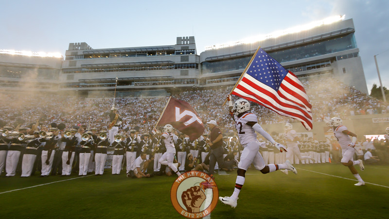 Chamarri Conner carries the American flag onto the field during Enter Sandman.(Mark Umansky/TheKeyPlay.com)