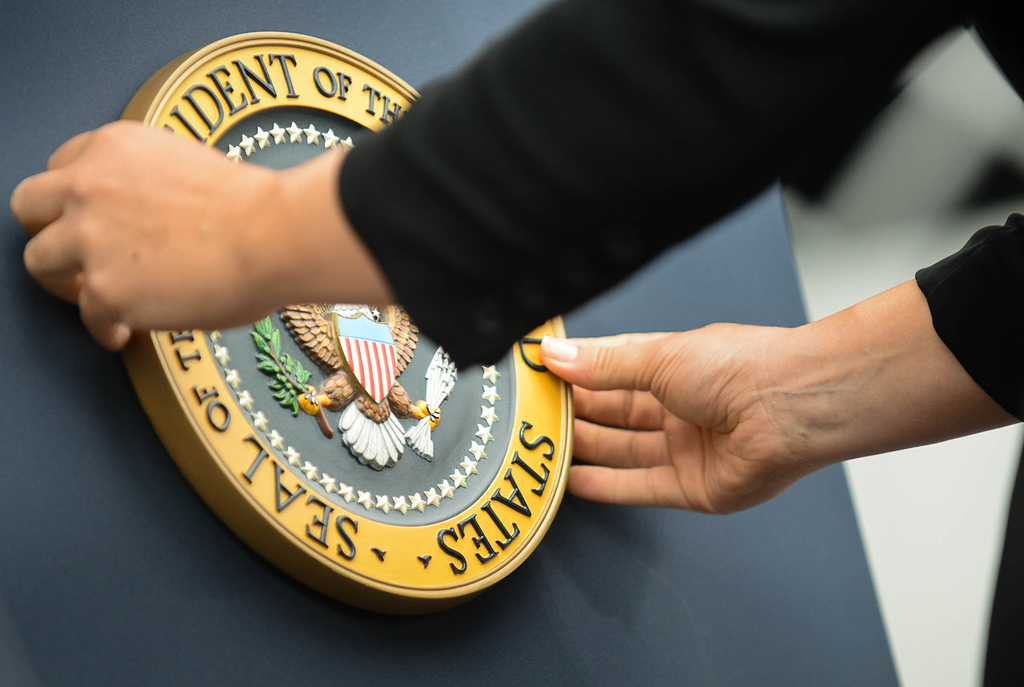 . The presidential seal is affixed to his podium prior to President Barack Obama  speech on economic issues at the Lake Harriet Bandshell. (Pioneer Press: Ben Garvin)