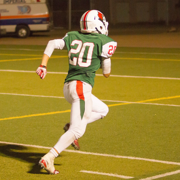 Jonathan Hadley (20) races to the Cardinal end zone after catching a pass late in the  Avenal Buccaneer at Lindsay Cardinal slugfest. Hadley's catch sealed a 15-8 win for Lindsay.