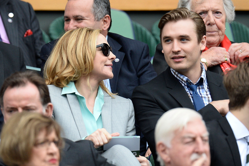 . LONDON, ENGLAND - JULY 02:  Kim Cattrall  and Seth Numrich sit in the Royal Box before the Ladies\' Singles quarter-final match between Agnieszka Radwanska of Poland and Na Li of China on day eight of the Wimbledon Lawn Tennis Championships at the All England Lawn Tennis and Croquet Club at Wimbledon on July 2, 2013 in London, England.  (Photo by Dennis Grombkowski/Getty Images)