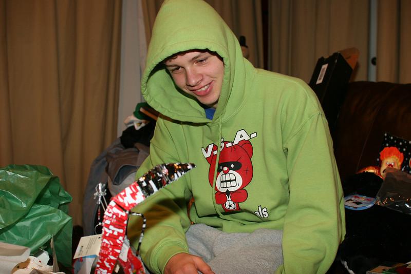 Caleb admiring his recycled soda can iguana playing a guitar