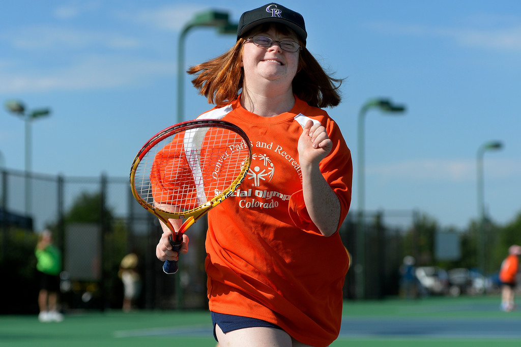 . DENVER, CO. - AUGUST 17: Gina Rea, of Littleton, smiles during the individual skills tennis competition in the Special Olympics state championship at the Lowry Sports Complex in Denver, CO August 17, 2013. Special Olympics Colorado hosted its state championship in Bocce, Cycling, Golf, Softball and Tennis. Six hundred athletes competed in the events, which was supported by 250 volunteers and coaches. (Photo By Craig F. Walker / The Denver Post)
