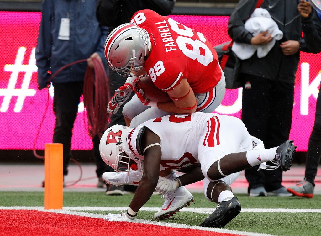 . Ohio State tight end Luke Farrell, (89) scores a touchdown past Rutgers defensive back Avery Young during the first half of an NCAA college football game Saturday, Sept. 8, 2018, in Columbus, Ohio. (AP Photo/Jay LaPrete)