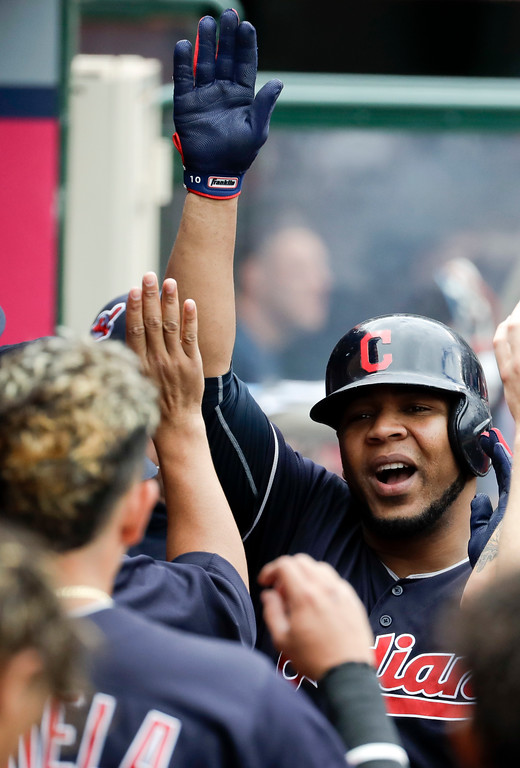 . Cleveland Indians designated hitter Edwin Encarnacion celebrates in the dugout after a home run against the Los Angeles Angels during the second inning of a baseball game in Anaheim, Calif., Thursday, Sept. 21, 2017. (AP Photo/Chris Carlson)