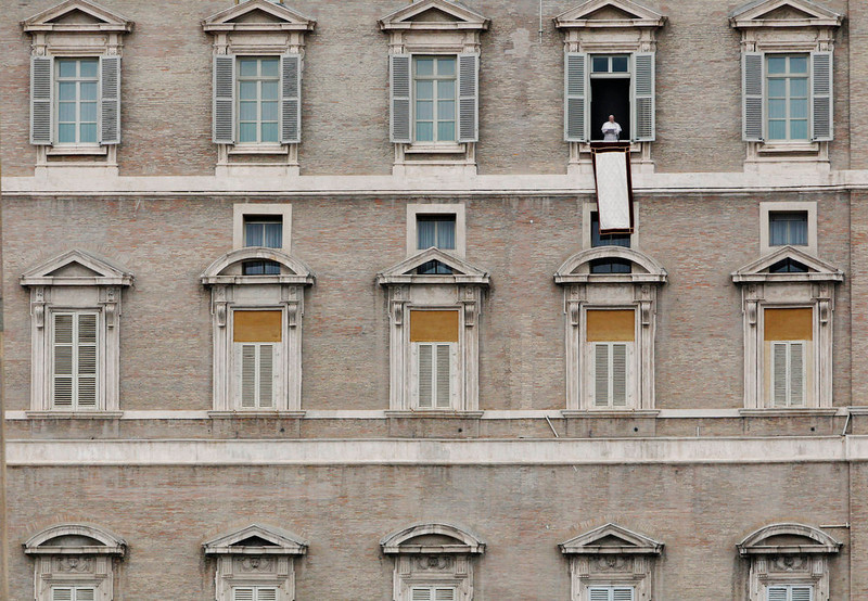 . Pope Francis speaks to the crowd in St. Peter\'s Square from the window of his residence before the Angelus prayer at the Vatican, Sunday, March 17, 2013. (AP Photo/Dmitry Lovetsky)