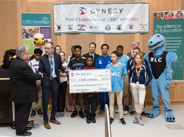 04/03/18 Wesley Bunnell | Staff Representatives from Dynegy, a power generating company in the Northeast, MId-Atlantic, Midwest and Texas, presented a $100,000 donation to CREC Athletics. The donation will be used towards the continuation of middle school sports at five participating CREC schools for the upcoming year. CREC Superintendent Tim Sullivan, far L, shakes hands with Vice President of Dynegy Plant Operations Peter Ziegler during the ceremonial check presentation as they are flanked by middle school athletes benefitting from the donation.