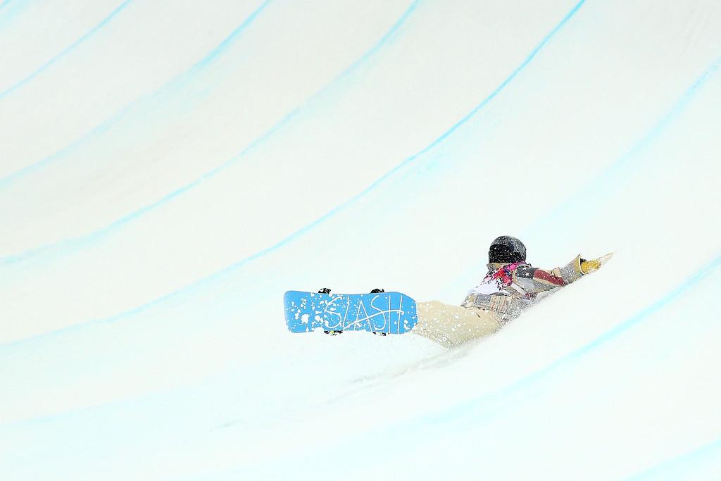. Gregory Bretz of the United States crashes out in the Snowboard Men\'s Halfpipe Finals on day four of the Sochi 2014 Winter Olympics at Rosa Khutor Extreme Park on February 11, 2014 in Sochi, Russia.  (Photo by Cameron Spencer/Getty Images)