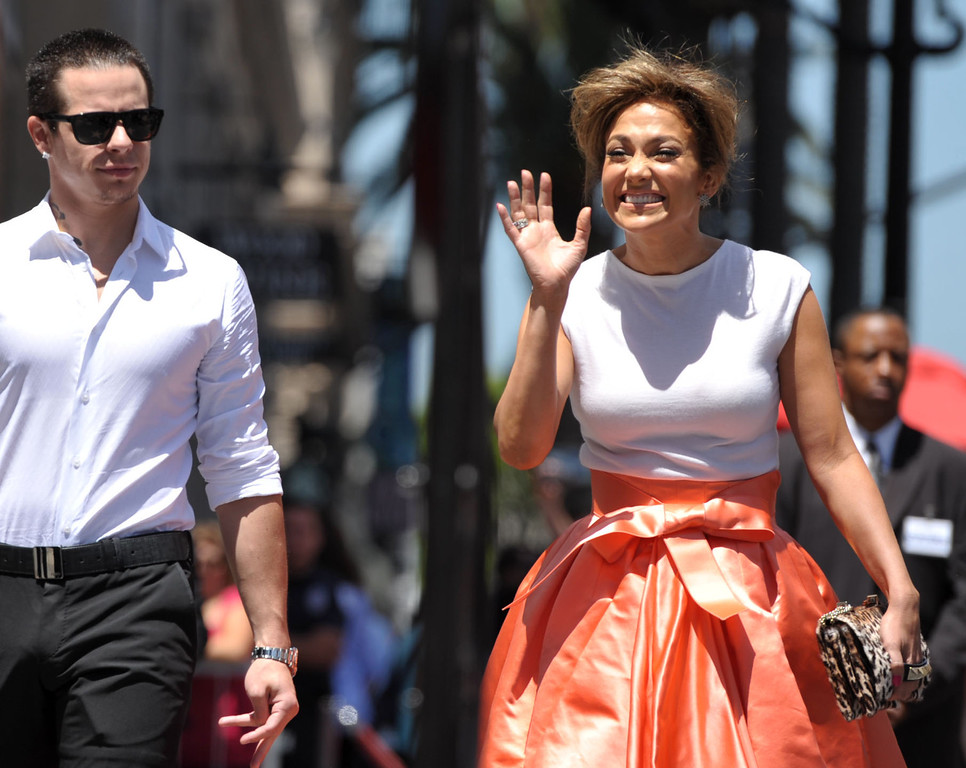 . Jennifer Lopez, right, and Casper Smart appear at a ceremony honoring her with a star on the Hollywood Walk of Fame on Thursday, June 20, 2013 in Los Angeles. (Photo by John Shearer/Invision/AP)