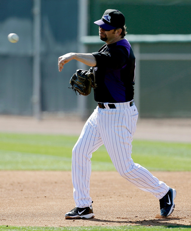 . Colorado Rockies\' Todd Helton throws to second base during a spring training baseball workout, Sunday, Feb. 17, 2013, in Scottsdale, Ariz. (AP Photo/Darron Cummings)