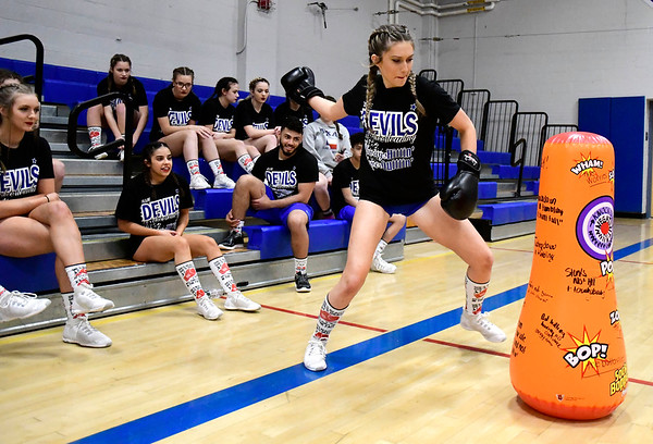 3/6/2020 Mike Orazzi | Staff Plainville High School Cheerleader's Olivia Haddad punches out her negative thoughts while preparing for the state competition on Friday night at PHS.