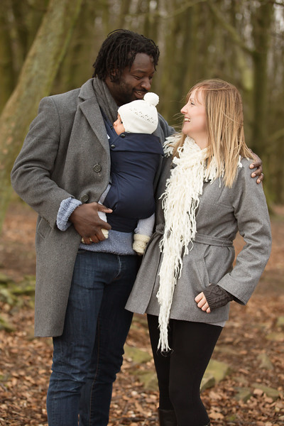 Izmi_Baby_Carrier_Cotton_Midnight_Blue_Lifestyle_Front_Carry_Couple_In_Woodland_Portrait.jpg