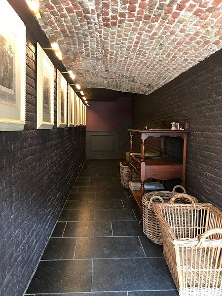The tiny low ceilinged hallway out to the patio on the canal