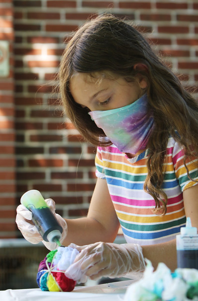 Lawrence Library in Pepperell hosts a socially-distanced tie-dye event, sponsored by Friends of the Lawrence Library. Olivia Stenson, 8, of Pepperell, works on her tie-dye. (SUN/Julia Malakie)