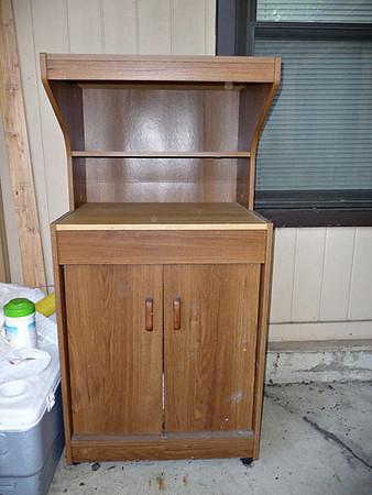 Microwave/kitchen hutch.  $15