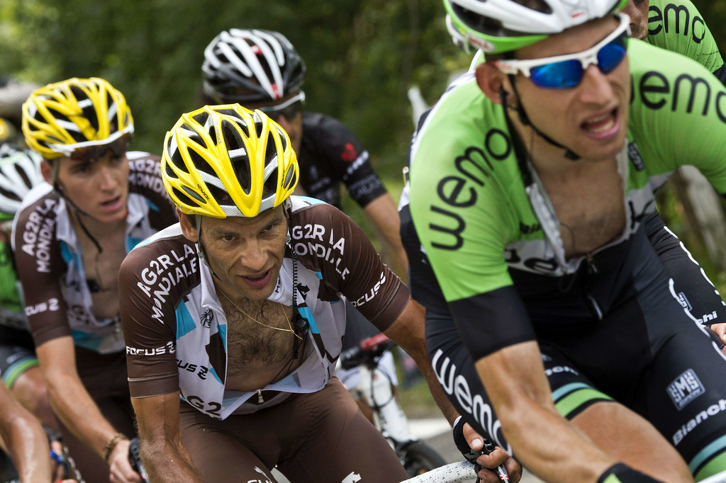 . France\'s Jean-Christophe Peraud (C) rides in a breakaway during the 145.5 km eighteenth stage of the 101st edition of the Tour de France cycling race on July 24, 2014 between Pau and Hautacam, southwestern France.  AFP PHOTO / LIONEL BONAVENTURE/AFP/Getty Images