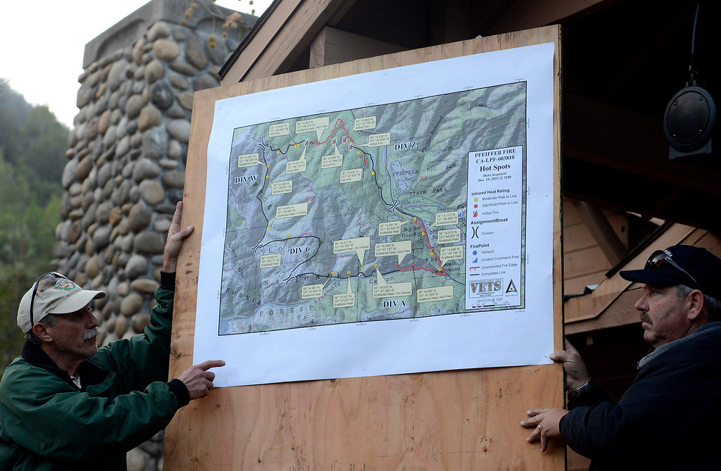 . Dana D\'Andrea U.S. Forest Service deputy incident commander points  to a map of Pfeiffer Ridge Fire hotspots in Big Sur, Calif. on Thursday December 19, 2013. Jeff Jones of the Central Coast Incident Management Team is at right. (Photo David Royal/ Monterey County Herald)