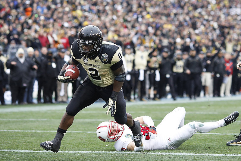 . Zac Stacy #2 of the Vanderbilt Commodores runs into the end zone for a six-yard touchdown against the North Carolina State Wolfpack during the Franklin American Mortgage Music City Bowl at LP Field on December 31, 2012 in Nashville, Tennessee. (Photo by Joe Robbins/Getty Images)