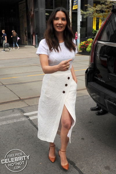 Olivia Munn In Stylish White Skirt And See Through Top In Toronto, Canada