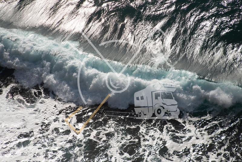 aerial image of waves of the wild ocean hitting onto the cliffs of the coast of Sao Miguel Island
