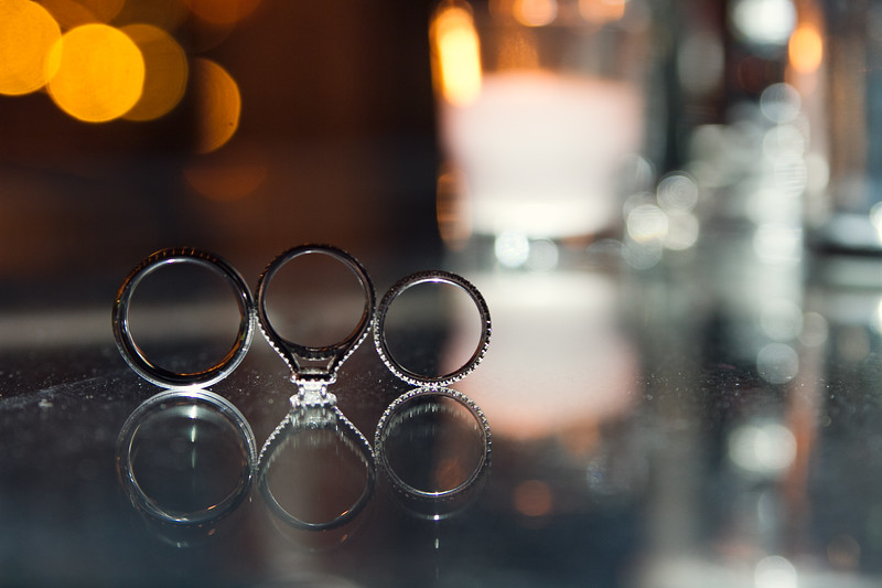 wedding rings reflected in table