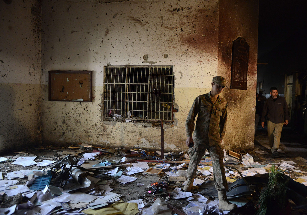 . A Pakistani soldier walks amidst the debris in an army-run school a day after an attack by Taliban militants in Peshawar on December 17, 2014. Militants rampaged through an army-run school in the northwestern city of Peshawar and killed at least 141 people, almost all of them children, in the bloodiest ever terror  attack in Pakistan.  AFP PHOTO / A  Majeed/AFP/Getty Images