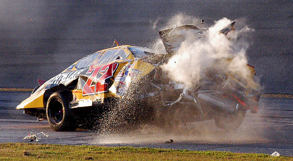 . The car of NASCAR driver Scott Wimmer (22) crashes to the track after flipping through the air during a multi-car wreck in Turn 3 and 4 during the Daytona 500 at the Daytona International Speedway in Daytona Beach, Fla., on Sunday, Feb. 20, 2005. (AP Photo/Rob Sweeten)