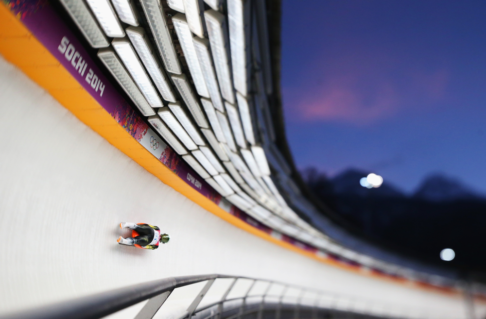 . (EDITORS NOTE: Image was created using a variable planed lens.) Eliza Tiruma of Latvia in action during the Women\'s Luge Singles on Day 4 of the Sochi 2014 Winter Olympics at Sliding Center Sanki on February 11, 2014 in Sochi, Russia.  (Photo by Julian Finney/Getty Images)