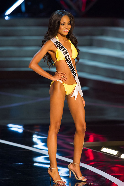 . In this photo provided by the Miss Universe Organization,  Miss North Carolina USA 2013, Ashley Love-Mills,  competes in her swimsuit during the  2013 Miss USA Competition Preliminary Show in Las Vegas on Wednesday June 12, 2013.   She will compete for the title of Miss USA 2013 and the coveted Miss USA Diamond Nexus Crown on June 16, 2013.  (AP Photo/Miss Universe Organization, Darren Decker)