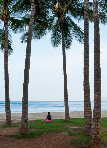 Woman Meditating Among the Palm Trees on a Hawaiian Beach