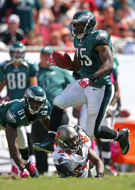. LeSean McCoy #25 of the Philadelphia Eagles jumps over Darrelle Revis #24 of the Tampa Bay Buccaneers during a game  at Raymond James Stadium on October 13, 2013 in Tampa, Florida.  (Photo by Mike Ehrmann/Getty Images)
