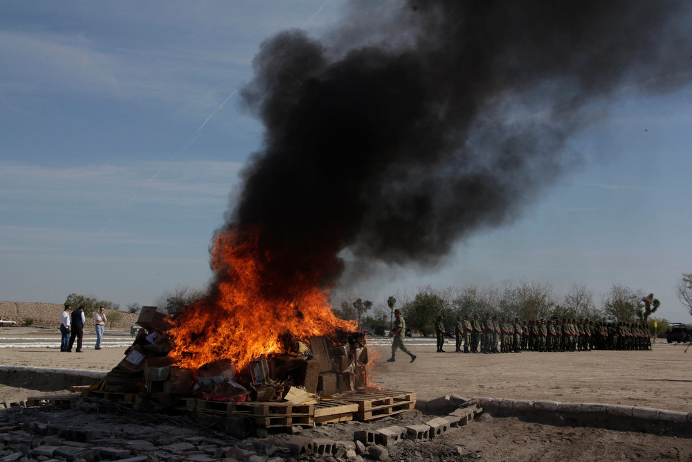 Description of . A burning pile of marijuana and other drugs is pictured at the 7th Military Zone on the outskirts of Monterrey November 1, 2012. More than a ton of narcotics, including marijuana, cocaine, methamphetamines and psychotropic pills were incinerated as part of the Nuevo Leon-Tamaulipas anti-drug operation, according to local media. REUTERS/Daniel Beceriil