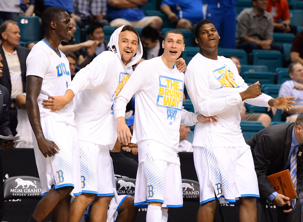 . (L-R) Wanaah Bail #1, Kyle Anderson #5, Zach LaVine #14 and Tony Parker #23 of the UCLA Bruins react to a dunk by teammate Noah Allen late in their semifinal game of the Pac-12 Basketball Tournament against the Stanford Cardinal at the MGM Grand Garden Arena on March 14, 2014 in Las Vegas, Nevada. UCLA won 84-59.  (Photo by Ethan Miller/Getty Images)