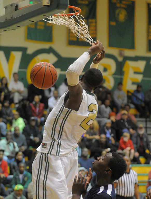 . 02-19-2012--(LANG Staff Photo by Sean Hiller)- Mayfair at Poly in the second round of the Division I-AA boys basketball playoffs Tuesday night.Jordan Bell dunks second quarter.