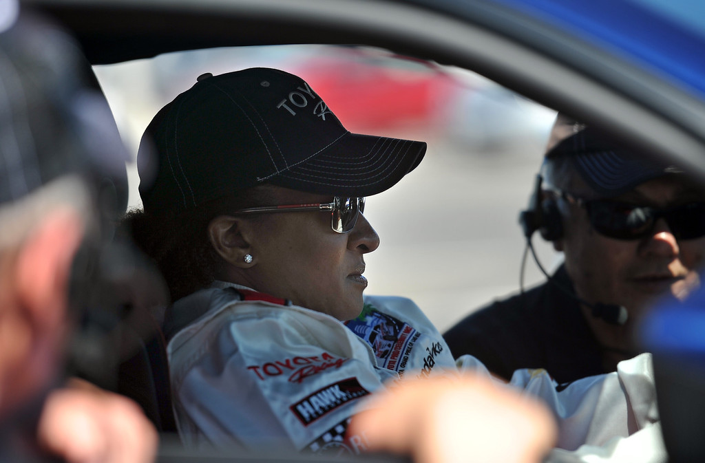 . 4/9/13 - Wanda Sykes gets instructions in her car during media day for the 39th Annual Toyota Grand Prix of Long Beach. The celebrity/pro races spent the day practicing on the track, joking with their racing partners and giving interviews. Photo by Brittany Murray / Staff Photographer