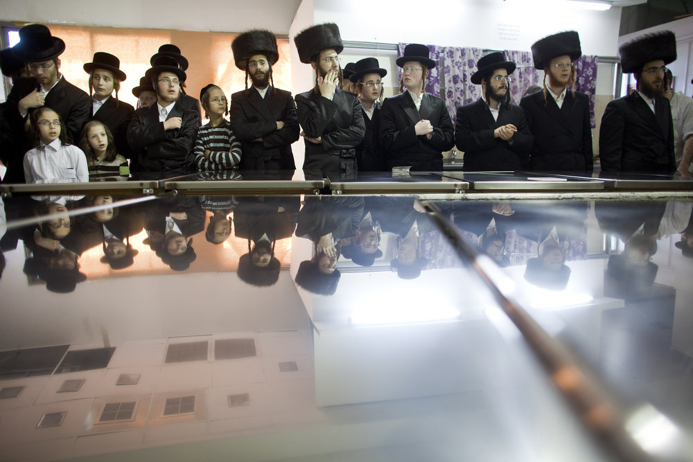 . Ultra-Orthodox Jewish men wait for their Rabbi before preparing Matzoth, or unleavened bread, in a final preparation before the start at sundown of the Jewish Pesach (Passover) holiday on March 25, 2013 in Bnei Brak, Israel. Religious Jews throughout the world eat matzoth during the eight-day Passover, or Pesach, holiday, The Jewish holiday commemorates the Israelis\' exodus from Egypt some 3,500 years ago and their ancestors\' plight by refraining from eating leavened food. Passover begins March 25 and ends on the evening of April 02.  (Photo by Uriel Sinai/Getty Images)