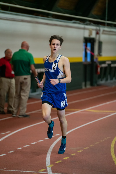 Junior Ben Huston crosses the finish line in the final leg of the 4x800 relay. VUHS takes home first place while setting an event record with a time of 8:42.92 in the Boys 4x800 relay. Vermont Division II Indoor Track State Championships - UVM Gutterson Field House - 2/16/2020