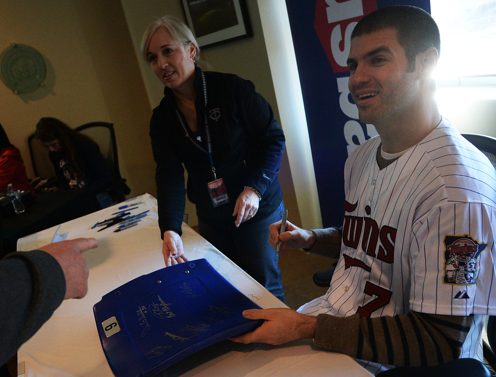. Twins first baseman Joe Mauer signs a Metrodome chair back at Twinsfest at Target Field, Saturday, January 25, 2014(Pioneer Press: John Autey)
