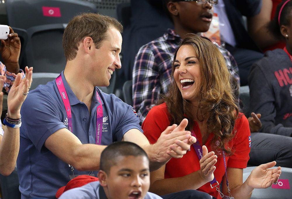 . Prince William, Duke of Cambridge and Catherine, Duchess of Cambridge share a joke as they clap while watching the track cycling on day 1 of the London 2012 Paralympic Games at the Velodrome on August 30, 2012 in London, England. St James\'s Palace has announced that Prince William and Catherine Duchess Of Cambridge are expecting a baby.  (Photo by Chris Jackson/Getty Images)