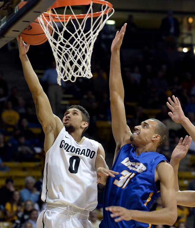 . University of Colorado\'s Askia Booker goes for a layup in front of Taran Brown during a game against  the University of California Santa Barbara, on Nov. 20, at the Coors Event Center in Boulder. (Jeremy Papasso/Boulder Daily Camera)