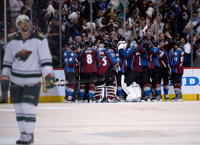 . The Colorado Avalanche team celebrates defeating the Wild 5 to 4 with an overtime goal made by Paul Stastny (26). The Colorado Avalanche hosted the Minnesota Wild for the first playoff game at the Pepsi Center on Thursday, April 17, 2014. (Photo by John Leyba/The Denver Post)