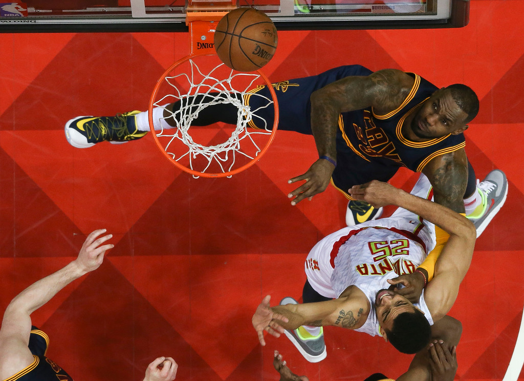 . Cleveland Cavaliers forward LeBron James (23) goes up for a shot against Atlanta Hawks forward Thabo Sefolosha (25) in of Game 3 of the second-round NBA basketball playoff series, Friday, May 6, 2016, in Atlanta. Cleveland won 121-108 and leads the best-of-seven series 3-0. (AP Photo/John Bazemore)