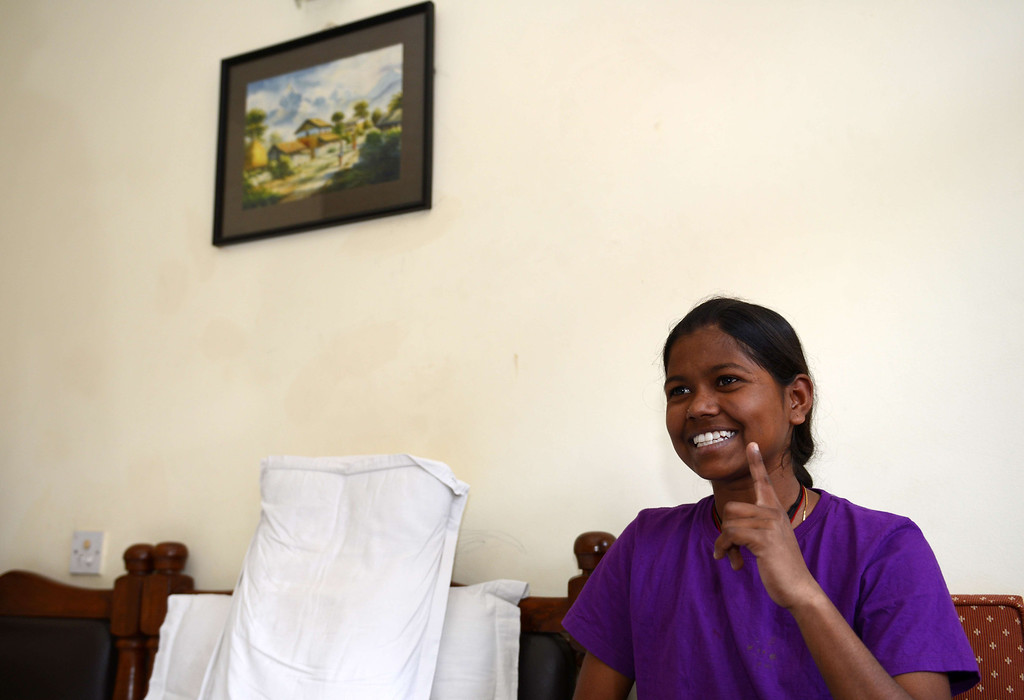 . Indian mountaineer Poorna Malavath, 13, gestures as she speaks during an interview with AFP in Kathmandu on June 2, 2014. The 13-year-old poor Indian schoolgirl who is the youngest female to summit Mount Everest said she had never climbed a mountain before setting her sights on the world\'s highest peak. Malavath Poorna, the daughter of a tribal farm laborer, reached the top of the 8,848-meter (29,029-foot) peak on May 25 following a difficult and dangerous climb from the Tibetan side of the mountain. AFP PHOTO/Prakash  MATHEMA/AFP/Getty Images