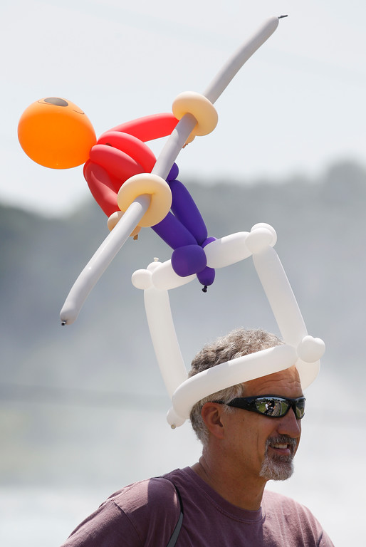 . Pat Kelecseny of Hermitage, Pa., wears a Nik Wallenda balloon hat before Wallenda\'s walk across Niagara Falls in Niagara Falls, N.Y., Friday, June 15, 2012. (AP Photo/David Duprey)