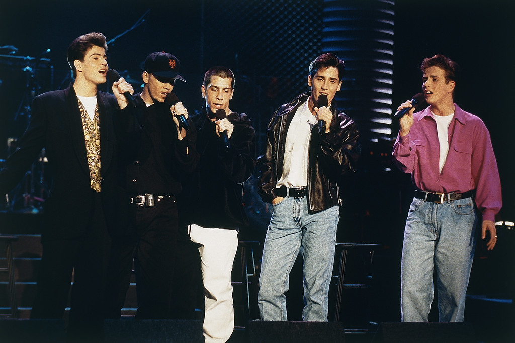 ". To counter recent charges made by their former musical director that they lip-sync on concerts and contributed less than 30 percent of the singing on their records, ""New Kids on the Block\"" perform live during taping of ?The Arsenio Hall Show? in Los Angeles, California, United States,  on Wednesday, Feb. 5, 1992. They are, from left, Joe McIntyre, Jonathan Knight, Danny Wood, Donnie Wahlberg and Jordan Knight. (AP Photo/Mark J. Terrill)"